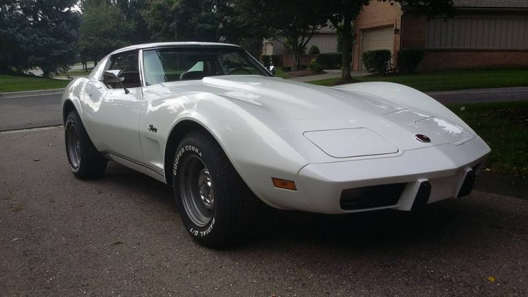 1975 white Corvette sitting by the curb