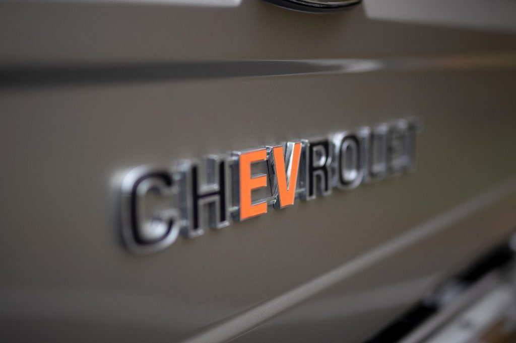 Chevrolet nameplate with red EV letters