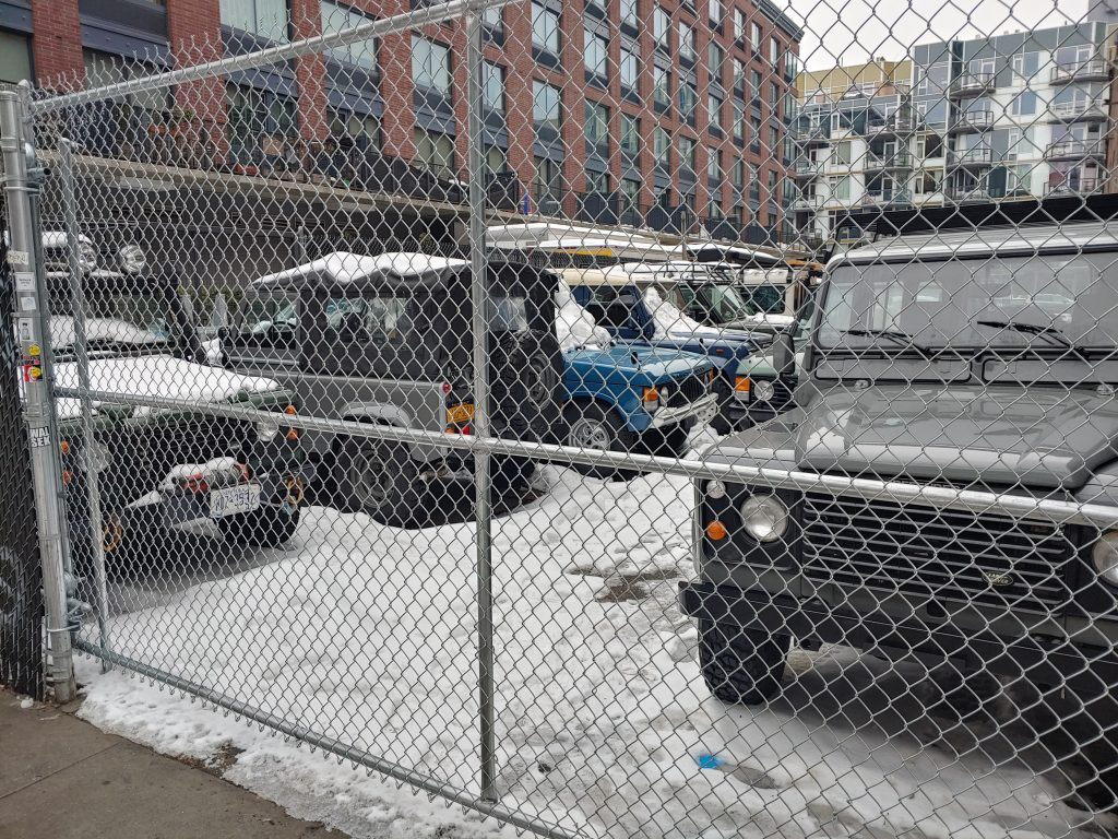 fence in front of Land Rovers