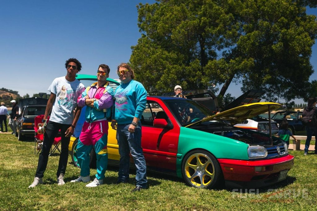 3 guys in front of a multi colored VW