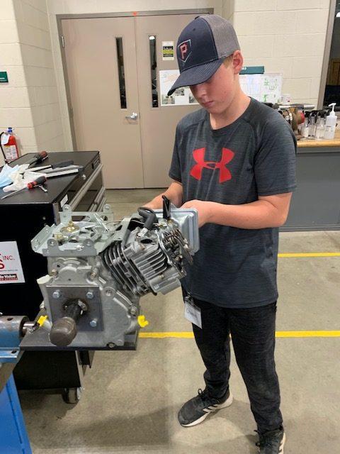 kid working on engine